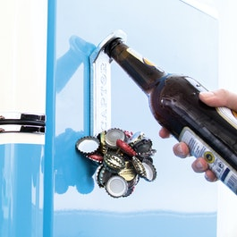 Magnetic bottle opener 'Captor' attaches to the fridge, with bottle cap collector on the front