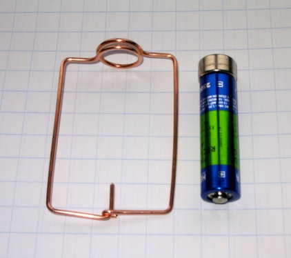 Homopolar motor with battery, copper wire, and magnet