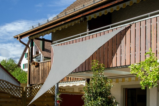 Shade sail secured with magnets. The magnets attach to the balcony railing.