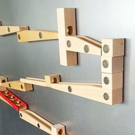 Magnetic wall marble run