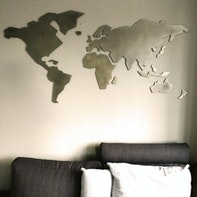 Metal world map as wall decoration