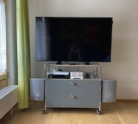 Hanging loudspeakers on a TV stand