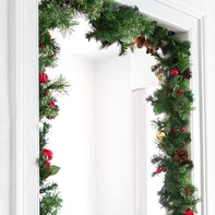 Attaching a Christmas garland and door wreath