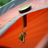 Magnetic hanger with metal lid for tents
