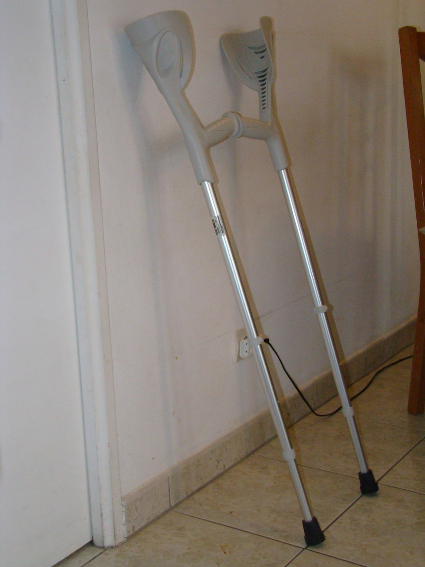The crutches stabilise each other on the wall