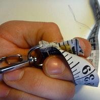 Schlüssel- und Maßband kombiniert