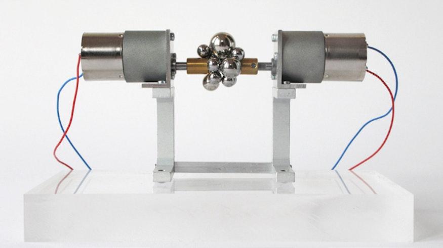 2 discos magnéticos y 15 esferas magnéticas de diferentes tamaños