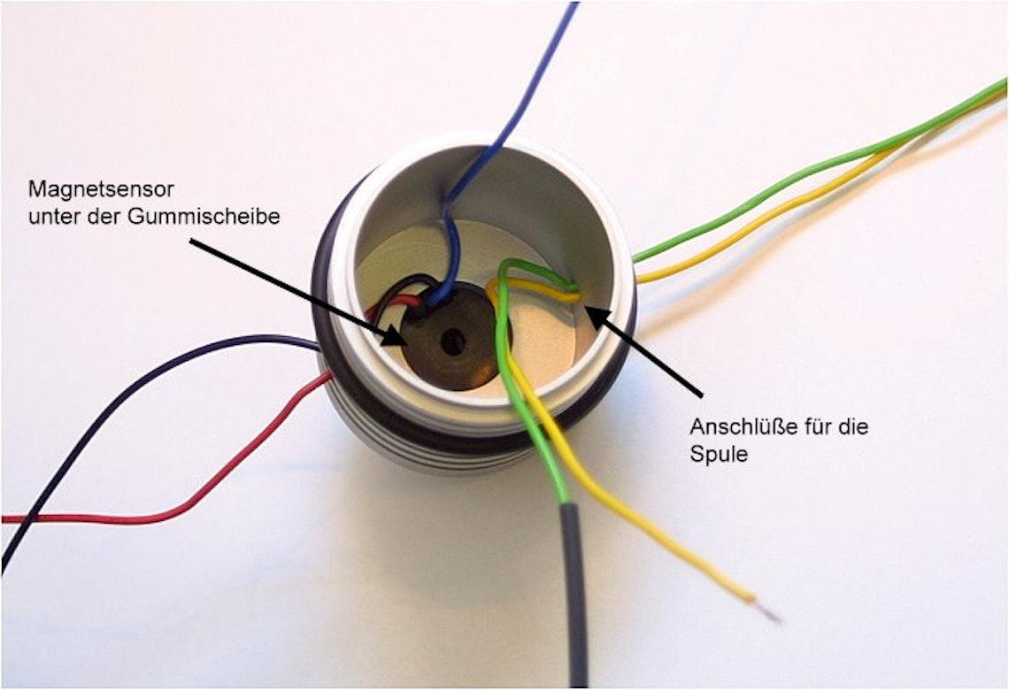 Interior del casquillo: el sensor de efecto hall se fija en la punta del casquillo con una arandela de goma.