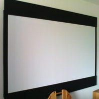 Projection screen with adjustable masking