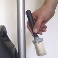 Attaching brush to hoover