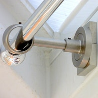 Fastening curtain rods